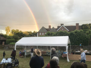 Photo of gazebo with rainbow